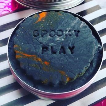 black playdough in tin