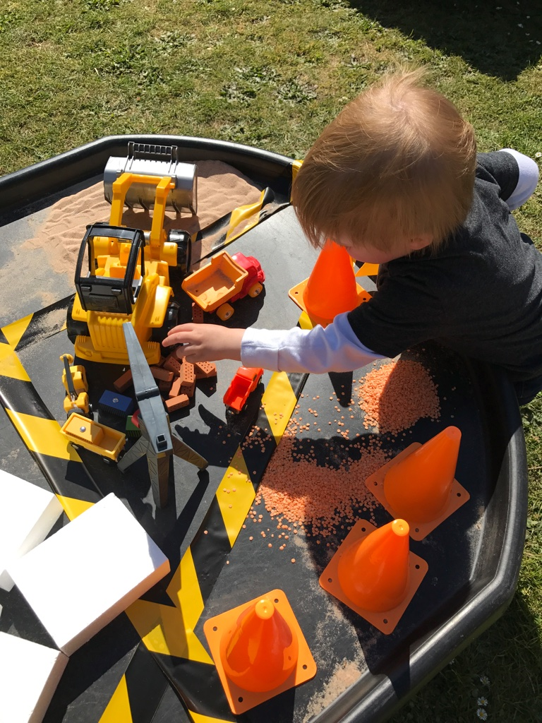 child playing construction tuff spot EYFS