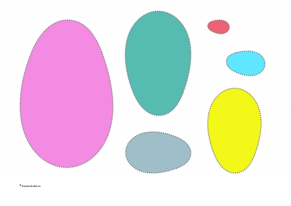 different sized eggs and Easter egg different coloured eggs to cut